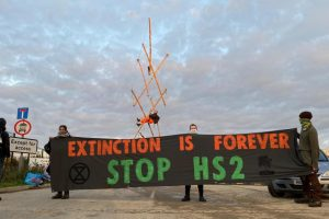 Protestors scale the HS2 tunnel and block works and remind Boris Johnson to keep his pledge to protect biodiversity