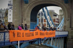 HS2 Rebellion drops banner from Tower Bridge; demandingthe government stop HS2 and protect UK drinking water